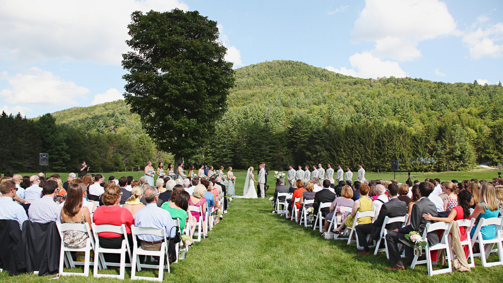 Vermont wedding ceremony in the Riverside Farm meadow