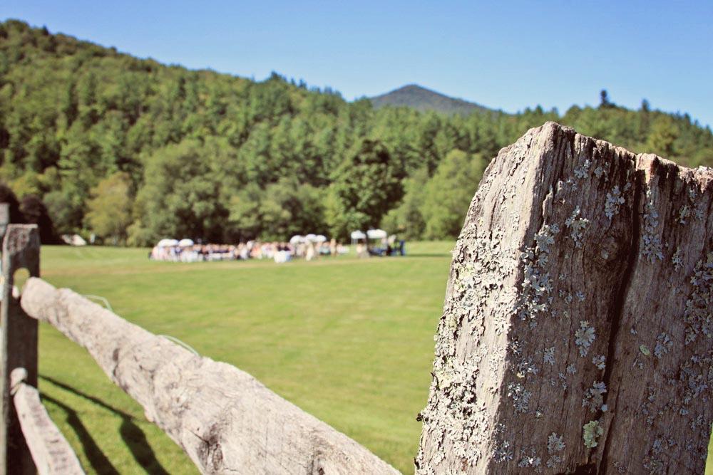 The wedding ceremony - seen through the classic farm fence