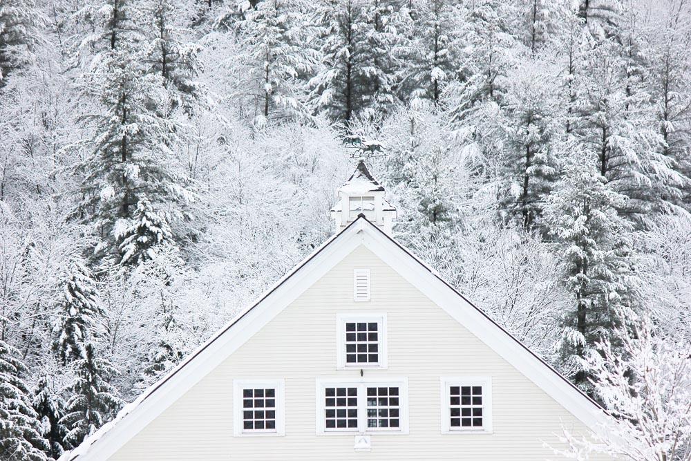 Riverside Farm's White Barn in Snow