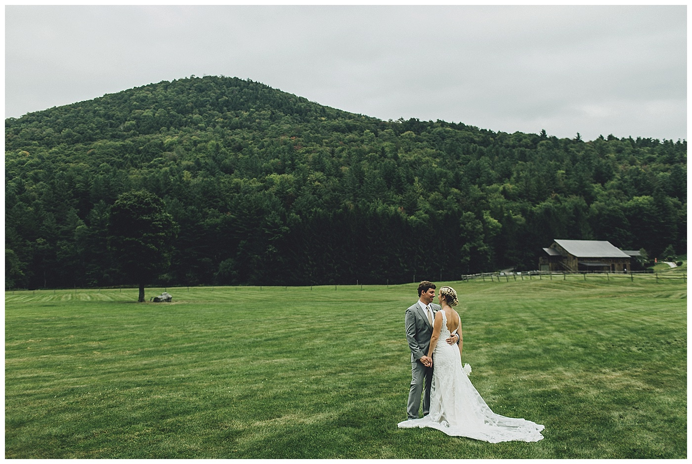 The Bride & Groom steal a quiet moment in the Riverside Farm wedding meadow.