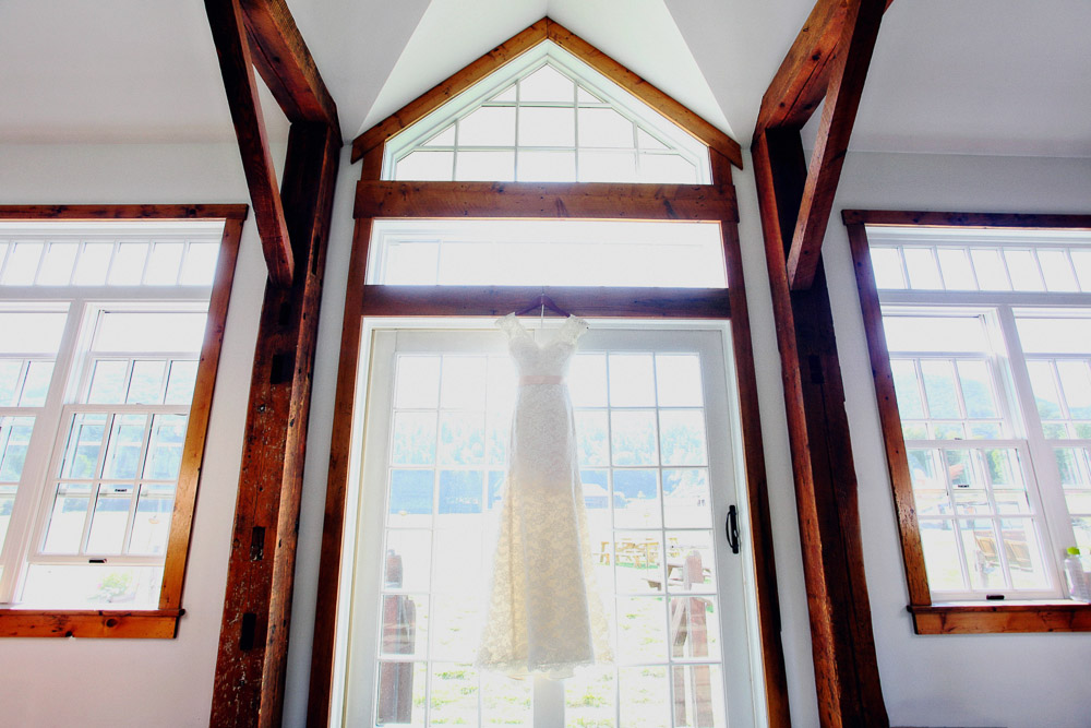 Wedding dress hanging in the barn