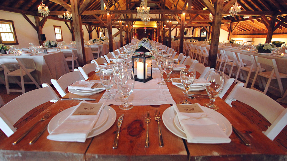 Wedding reception tables in the Brown Barn at Riverside Farm