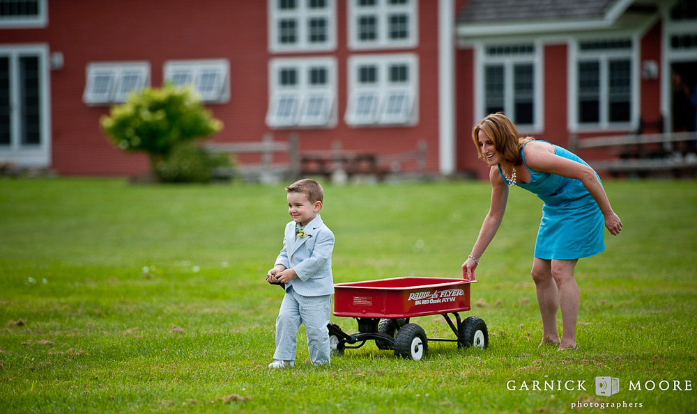 Ring bearer with red wagon