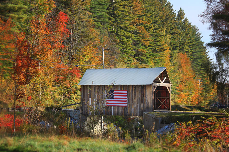 The covered bridge at Riverside Farm surrounded by fall color
