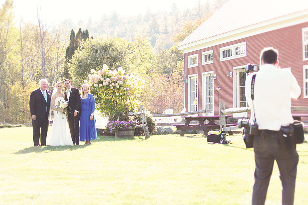 Photographer Sabin Gratz works with newly married couple at Riverside's Red Barn