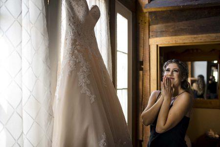 Bride admires wedding dress